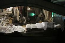 View through the moskito-net into the bedside of the trailer.